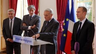 French Prime Minister Jean-Marc Ayrault (C), Transport Minister Frederic Cuvillier (L) and Agriculture Minister Stephane Le Foll announce the ecotax's suspension