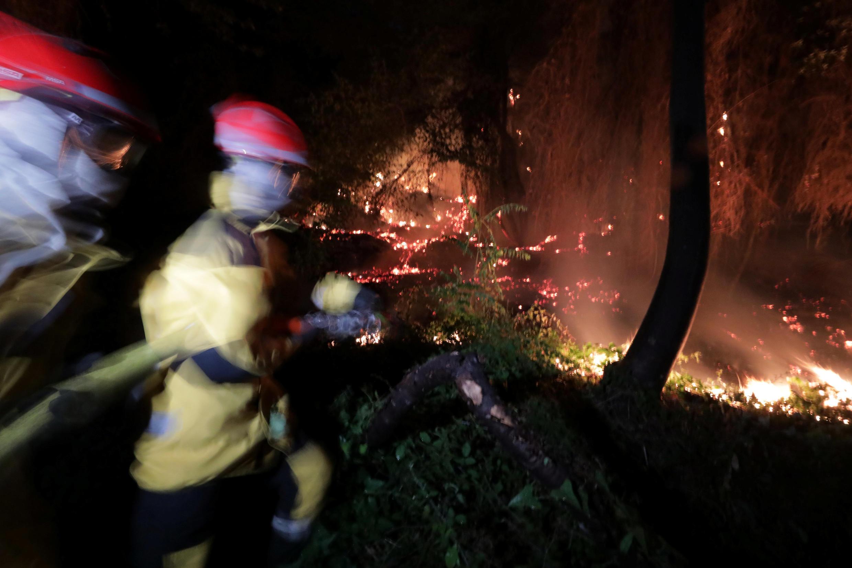 Firefighters last night at Castagniers, near Nice