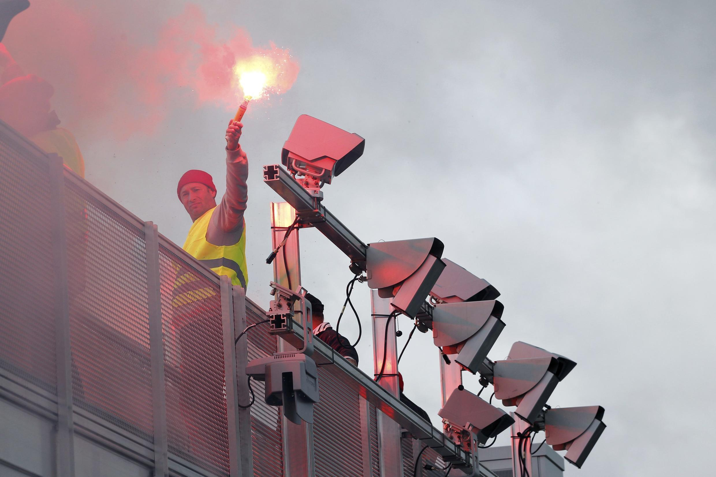 A protester holding a safety flare during a protest against the ecotax in Brittany last weekend