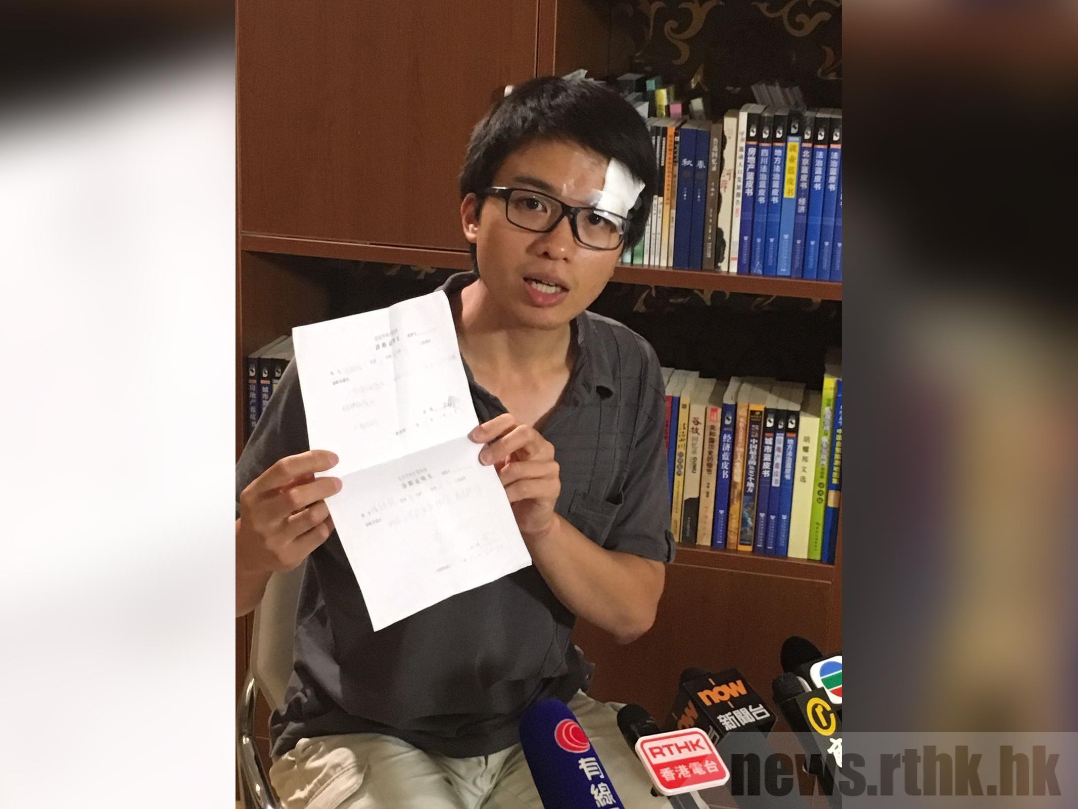 香港Now新闻台驻北京摄影记者徐骏铭采访时遭到便衣人员和警员殴打