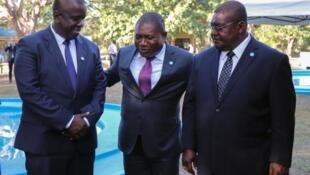 Daiviz Simando, presidente do MDM, Filipe Nysi, chefe de Estado de Moçambique, e Ossufo Momade, líder da Renamo