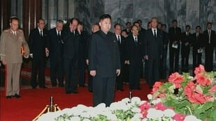 Kim Jon Un paying his respects to his late father Kim Jong Il