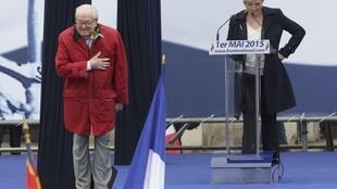 Jean-Marie Le Pen (L) steals his daughter Marine's thunder at the party's traditional 1 May rally