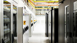 Servers secured behind locked cabinets at the TeleCity Group data centre north of Paris