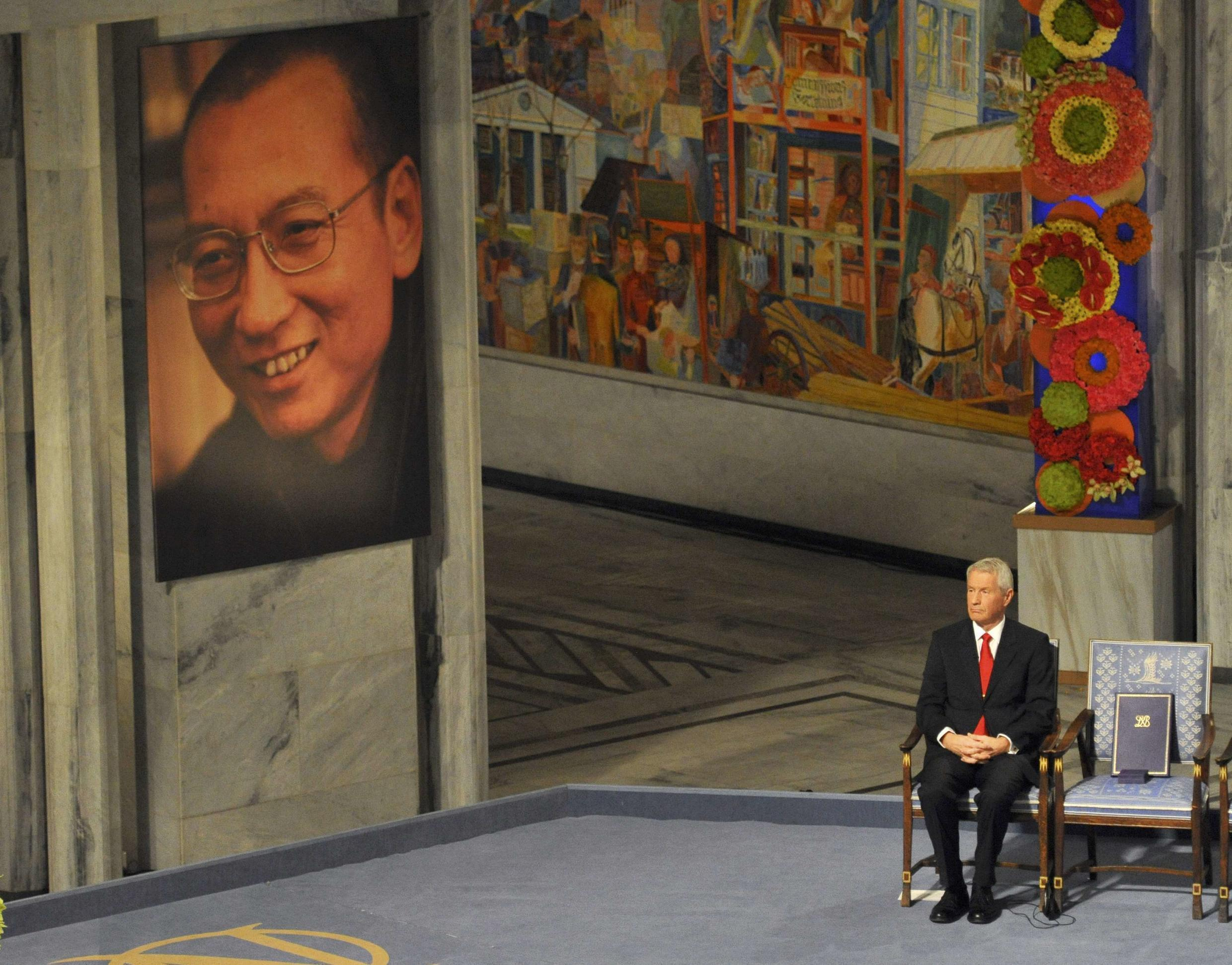 Nobel committee chair Thorbjorn Jagland next to the empty chair left for Liu Xiaobo