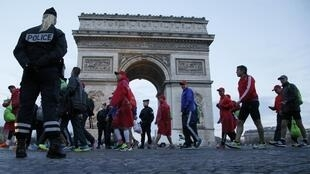 File photo of Paris' Arc de Triumphe as marathoners descended upon the city