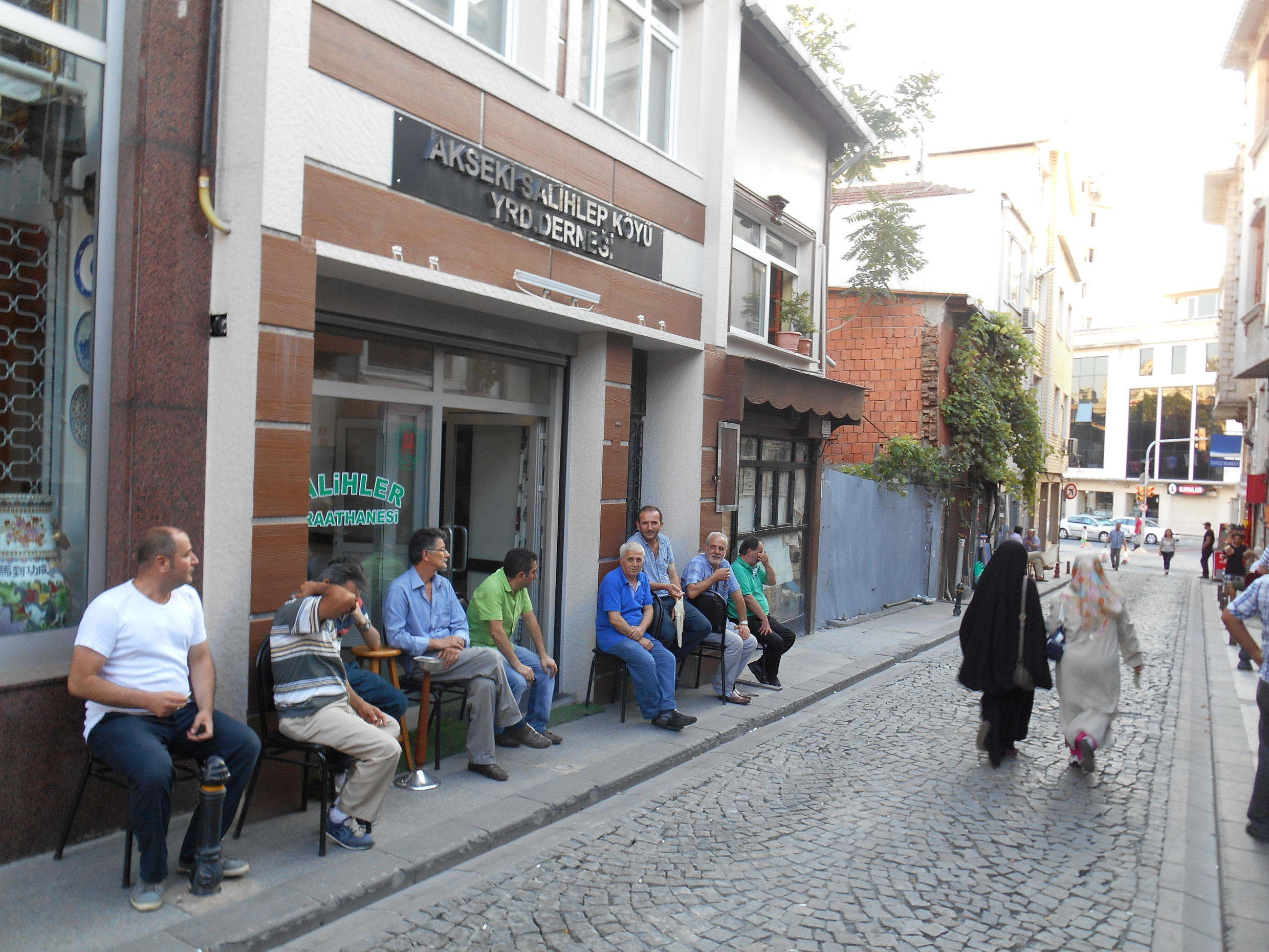 Men sit outside a cafe in Kasimpasa, the home area of Recep Tayyip Erdogan