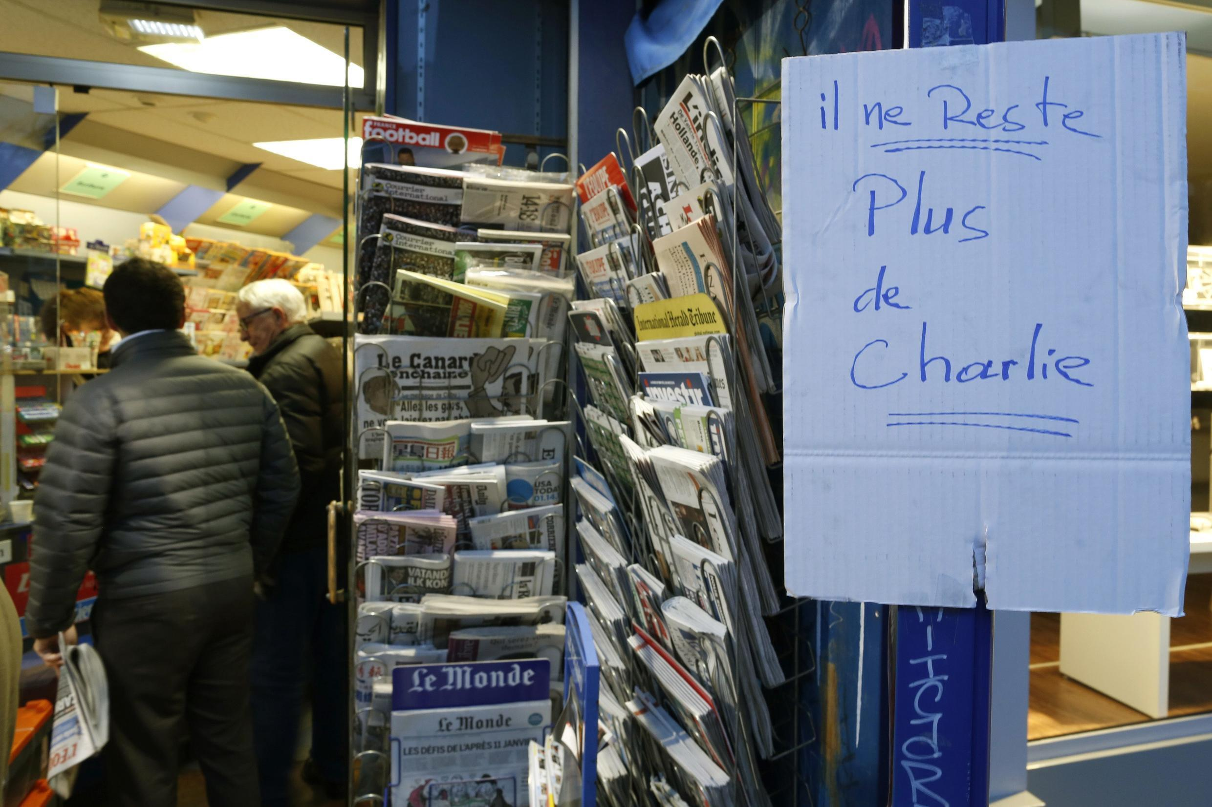 """""""No more Charlie"""" says this sign on a Paris newsstand Wednesday"""
