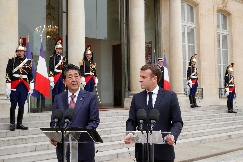Japan's Prime Minister Shinzo Abe with France's President Macron, April 23 2019.