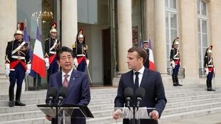 Japan's Prime Minister Shinzo Abe with France's President Macron, April 23 2019.