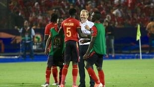Man with a plan: Sébastien Desabre (white shirt) has steered Uganda to the verge of the knockout stages at the Africa Cup of Nations for the first time in 41 years.