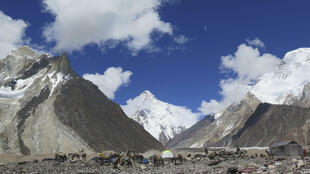 A Nepalese team has claimed the first winter asecent of K2 (C, pictured in summer) in the Karakoram range