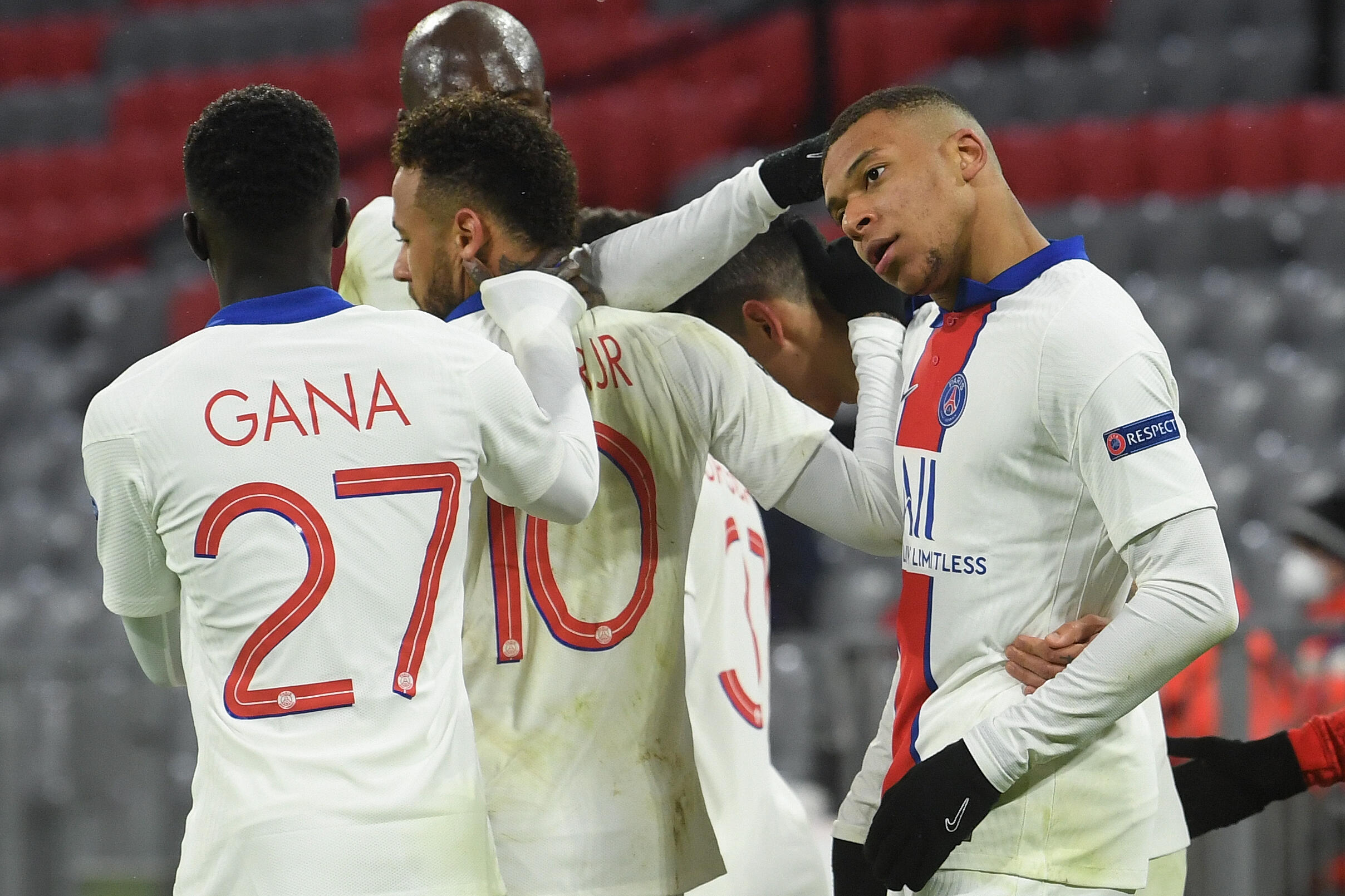 Kylian Mbappe (R) celebrates with his Paris Saint-Germain team-mates after scoring his second goal against Bayern Munich on Wednesday