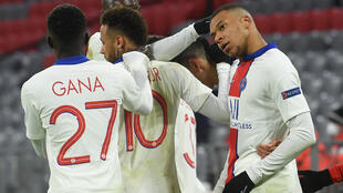 Kylian Mbappe (right) celebrates with his Paris Saint-Germain team-mates after scoring his second goal against Bayern Munich on Wednesday