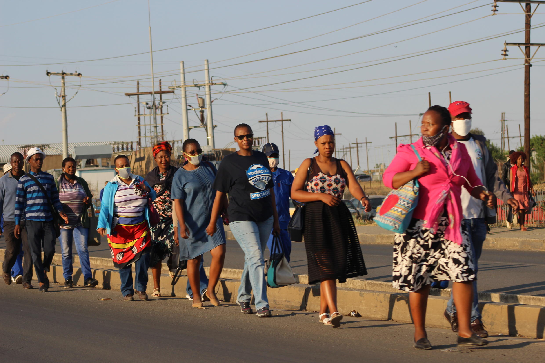 Walking to work due to the transport stike, Maseru, Lesotho
