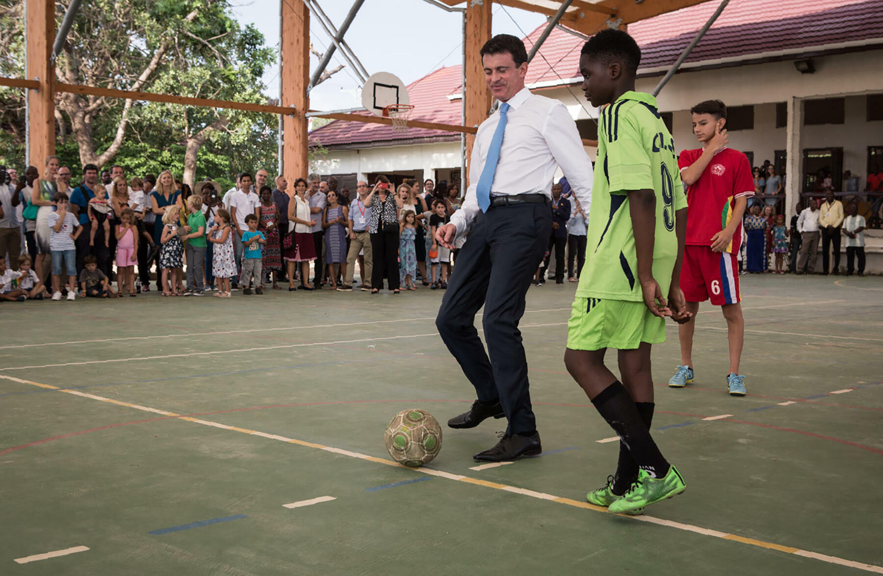 French Prime Minister Manuel Valls plays football with students at the lycée français in Accra