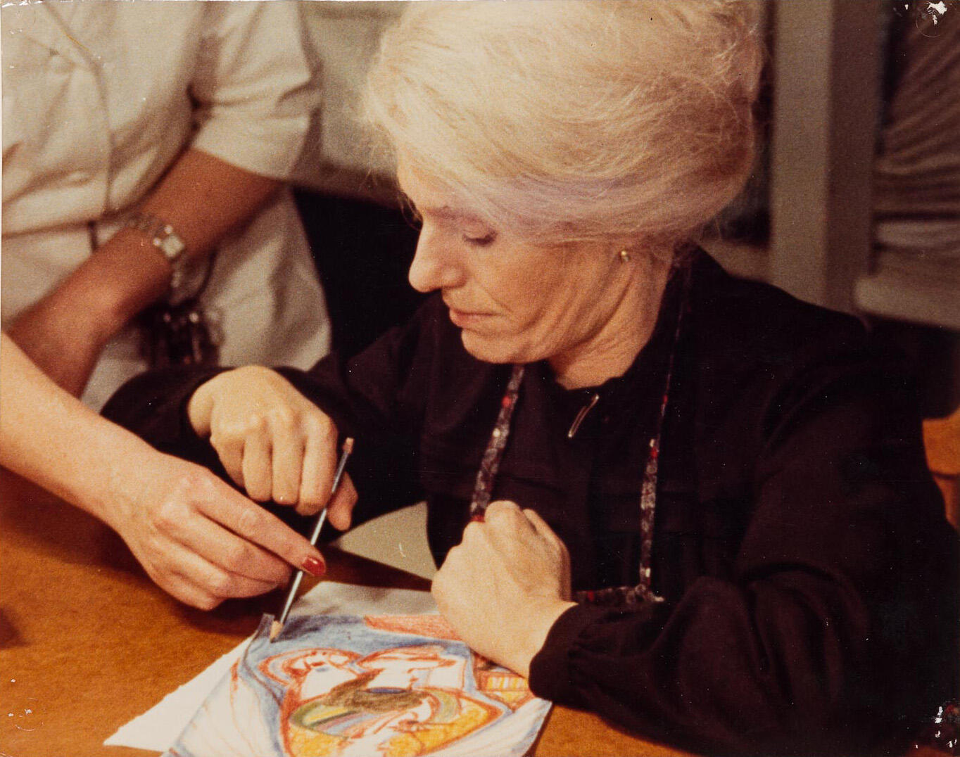 French actress and feminist militant Delphine Seyrig as Swiss painter Aloïse Corbaz, painting in Liliane de Kermadec's 'Aloïse', one of the films at the 1975 Cannes Film Festival