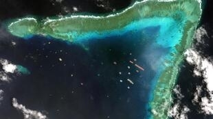 This satellite imagery taken on March 23 shows Chinese vessels anchored at the Whitsun Reef