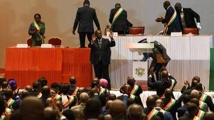 Ouattara gestures to MPs and senators in Yamoussoukro on 5 March 2020, after announcing he would not run in October's election.