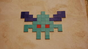 French street artist Invader produces pixelated works using bathroom tiles.