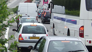 Traffic jam with bus and cars in France.