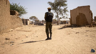 A Burkina Faso solider on patrol in Dori, a town in the north of the country, some 200km west of Djibo.