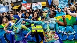 Dancers lead a demonstration for the protection of the ocean environment on World Oceans Day in Paris, 8 June, 2019.
