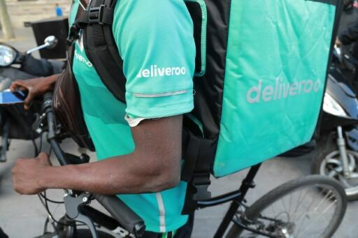 Tens of thousands of Deliveroo workers -- most of them young men on bikes and scooters -- are deprived of a minimum wage or paid leave