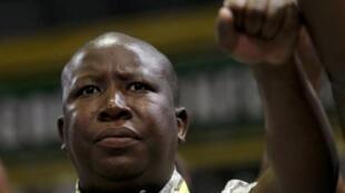 Julius Malema dances as South Africa's President Jacob Zuma speaks in Durban last month