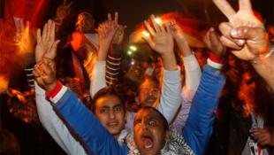 Opposition protesters in Cairo's Tahrir Square celebrate President Hosni Mubarak's resignation
