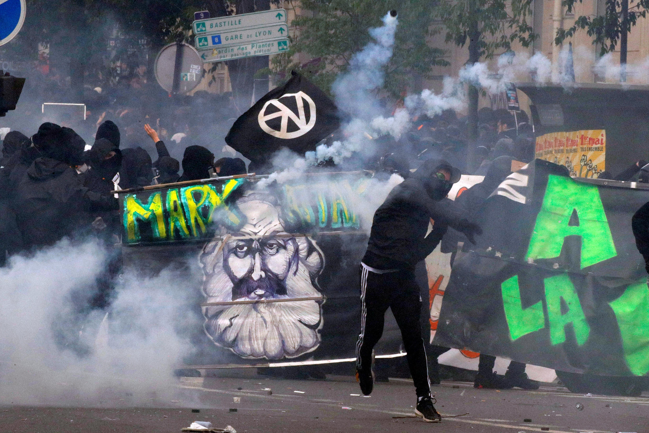 A demonstrator confronts police on the Paris May Day demonstration