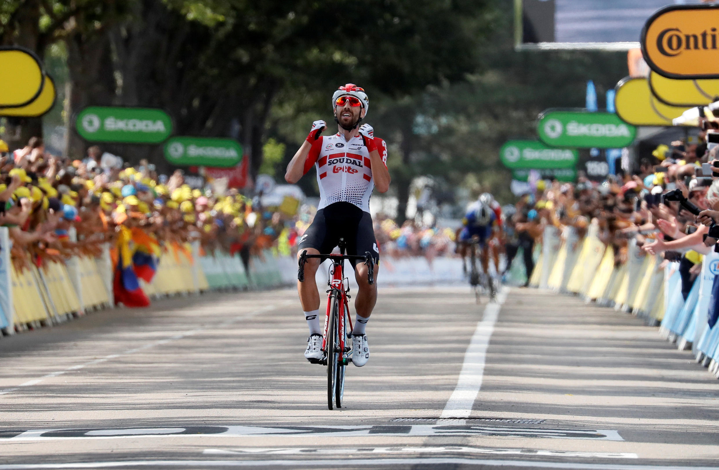 Thomas De Gendt of Belgium wins the 200-km stage 8 from Macon to St-Etienne ahead of the French duo of Thibaut Pinot and Julian Alaphilippe, 12 July 2019.