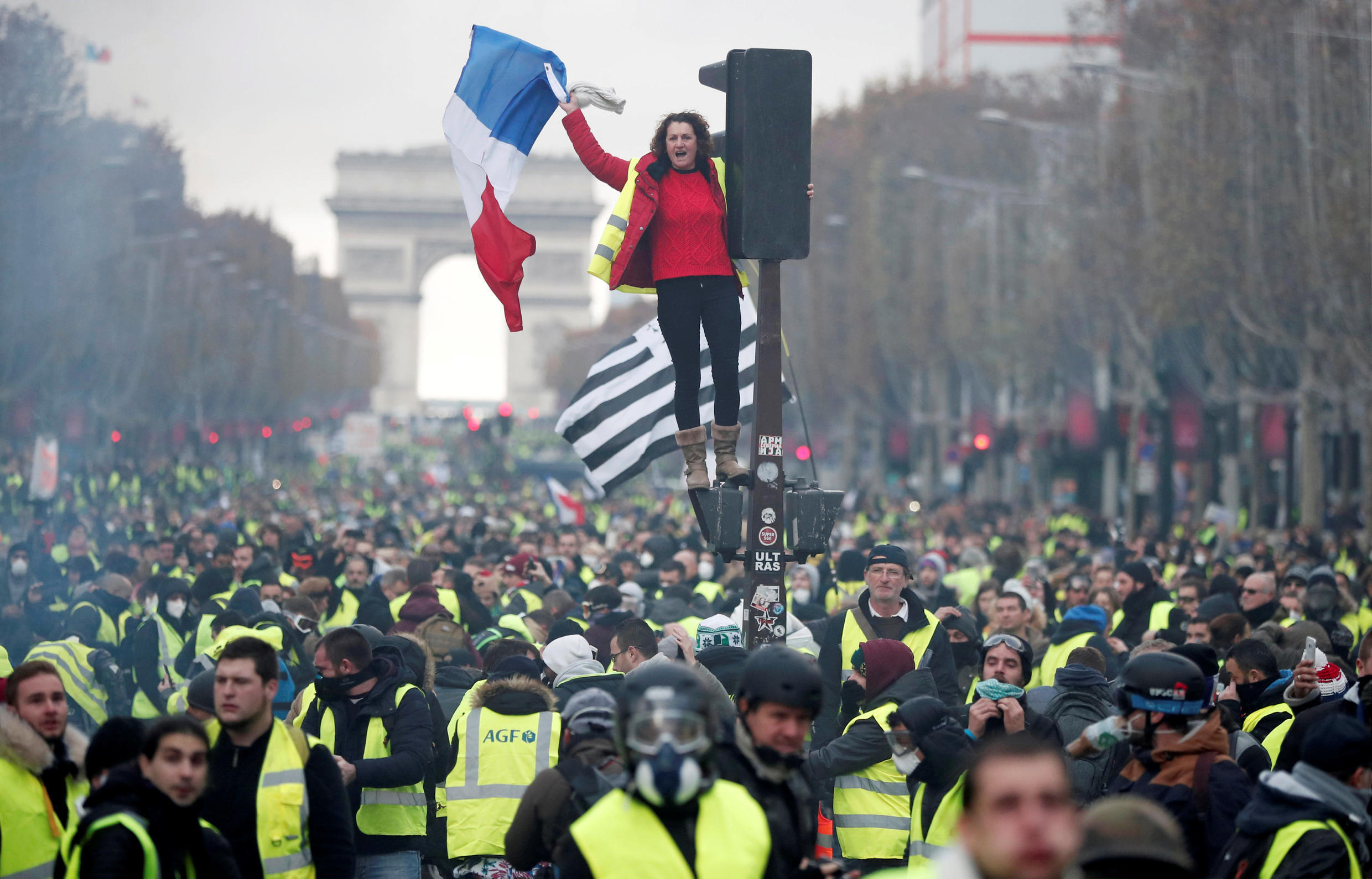 A protester wearing yellow vest, a symbol of a French drivers' protest against higher fuel prices,