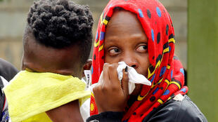 Relatives of a person, who was killed in an attack on an upscale hotel compound, grieve in Nairobi, Kenya January 16, 2019