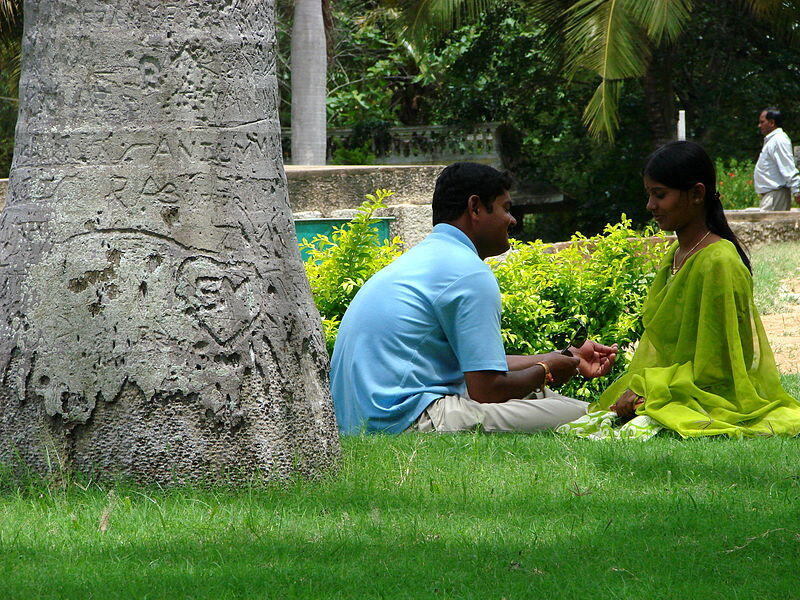 Couple in the garden outside Somnathpur Temple, near Mysore, India