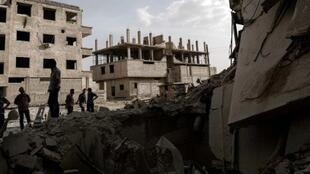 Пригород Дамаска Гута после бомбежки, 1 мая 2017 года.