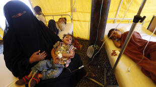 Yemeni children believed to be infected with cholera receive treatment at a makeshift hospital in Sanaa