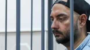 Russia's theatre and film director Kirill Serebrennikov, charged with fraud, standing inside a defendants' cage during a court hearing in Moscow on August 23, 2017