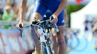 Laurent Vidal competes during the men's short distance at the ITU Triathlon World Championships Series in Kitzbuehel, Tyrol Province, on 24 June 2012.