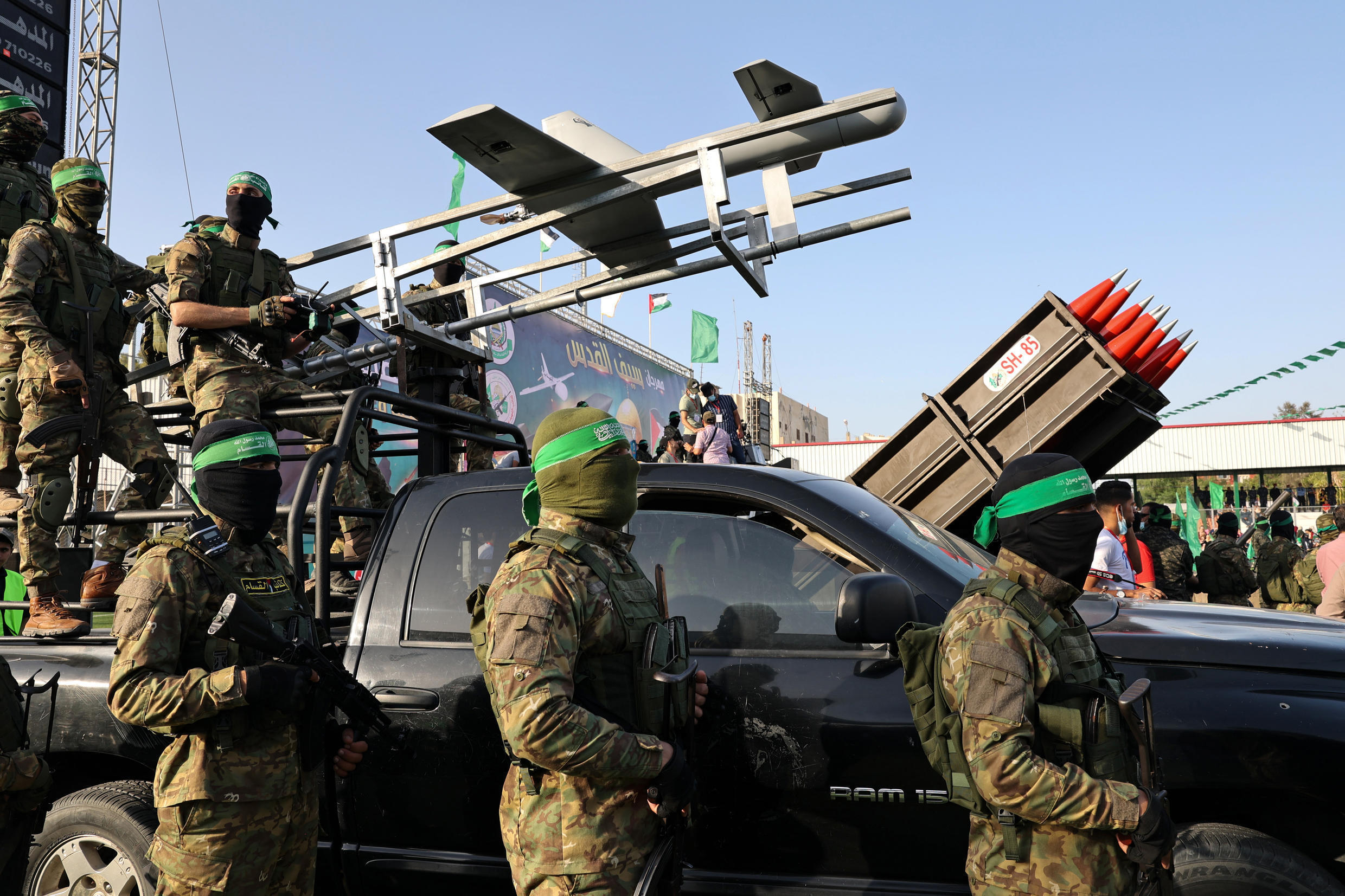 Fighters of the Hamas military wing Ezzedin al-Qassam Brigades display military hardware during a parade in the Gaza city of Rafah a week after Hamas and Israel agreed a ceasefire ending a deadly and devastating 11-day confrontation