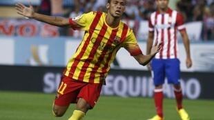 Neymar celebra seu primeiro gol pelo Barcelona no empate de 1 a 1 com o Atlético de Madri, em 21 de agosto de 2013.