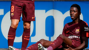 Ousmane Dembele réagit, après avoir subi une blessure, lors du match de Liga contre Getafe au stade Coliseum Alfonso Perez à Getafe, en Espagne, le 16 septembre 2017.