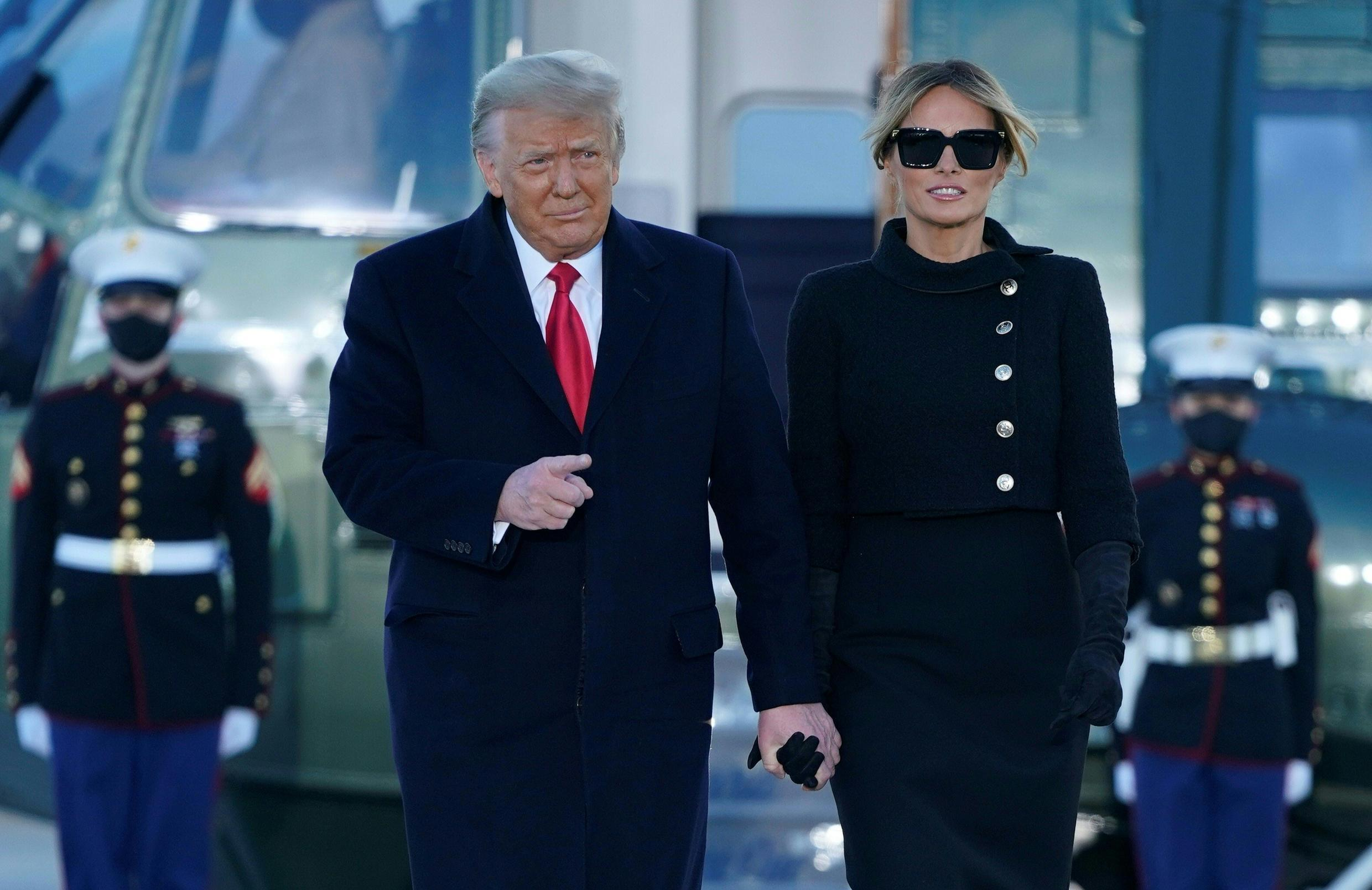 Former US president Donald Trump and first lady Melania Trump are seen at Joint Base Andrews in Maryland on January 20, 2021, after leaving the White House