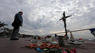 A woman stands near a memorial to the victims of the July 14 attack on the Promenade des Anglais, three days before a national tribute in Nice, France, October 12, 2016.