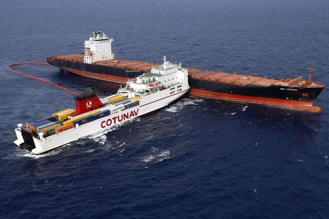 Aerial view taken from an helicopter on October 10, 2018 shows two cargo ships - the Tunisian freighter Ulysse (L) and the Cyprus-based vessel anchored CLS Virginia - after they collided about 30 kilometres (20 miles) off the northern tip of the French Med
