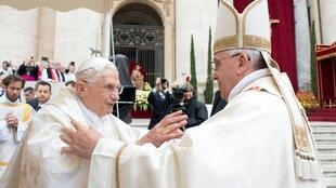 Pope Francis (R) embraces Pope Emeritus Benedict XVI during Mass before the canonisation ceremony of Popes John XXIII and John Paul II at St Peter's Square at the Vatican, April 27, 2014.