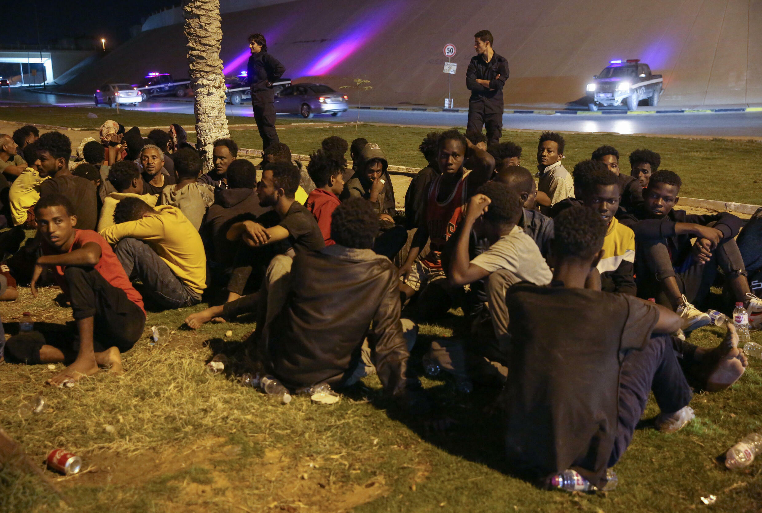 Libyan authorities round up migrants who attempted to join a mass breakout from an overcrowded Tripoli detention centre after guards shot dead six inmates