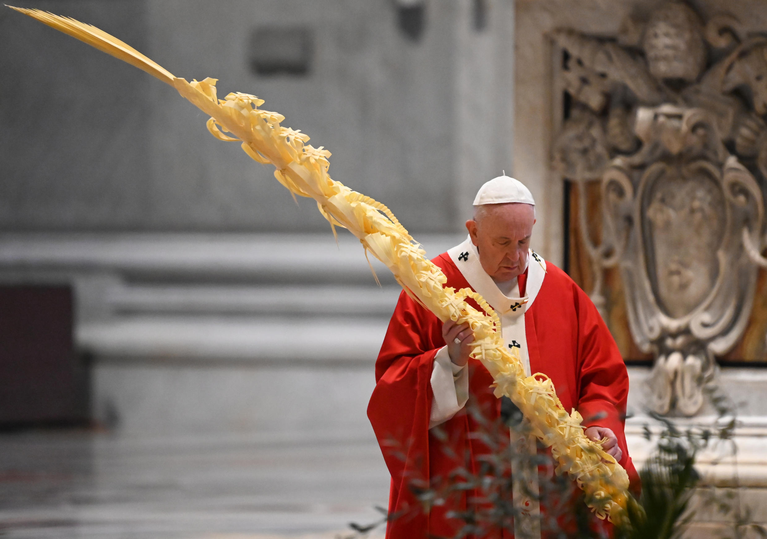 Pope Francis celebrated Palm Sunday mass behind closed doors at St Peter's on Sunday