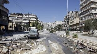An empty street in Salah al- Din neighborhood following clashes between the Free Syrian Army fighters and Syrian Army soldiers in central Aleppo, 8 August, 2012