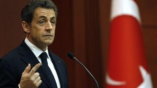 Nicolas Sarkozy speaks during a news conference at the presidential palace in Ankara, 25 February 2011